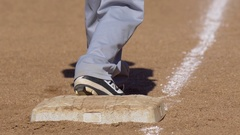 A boy stands on third base while playing in a little league baseball game. Stock Footage