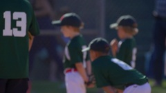A team of boys playing in a little league baseball game, slow motion. Stock Footage