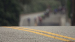 A peloton of men racing in a road bike bicycle race. Stock Footage