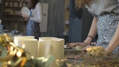Two women working in small ceramic studio Stock Footage