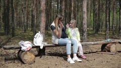 Pregnant mother and daughter outdoors. Stock Footage