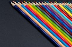 Color pencils isolated on black background close up Stock Photos