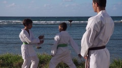 Happy Karate Sport Instructor Watching Young Boys Fighting And Training Stock Footage
