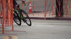 Men racing in a road bike bicycle race, super slow motion. Arkistovideo