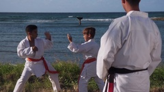 Portrait Of Confident Karate Trainer Watching Children Fight And Exercise Arkistovideo