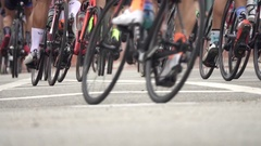 Men racing in a road bike bicycle race, super slow motion. Stock Footage