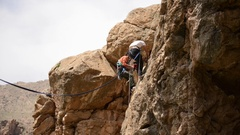 Aerial view of men rock climbing up a waterfall. Stock Footage