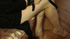 Seductive Woman in handcuffs hplding glasses. BDSM concept, accessories and sex Stock Footage