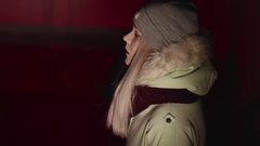 Beautiful young girl breathing at the cold dark place fashion style Stock Footage