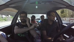 POV of four young men friends driving a car. Stock Footage
