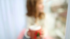 Close up of hands of child holding white mug in winter holiday cover Stock Footage