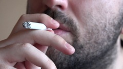 Close up 4K man with black beard smoking joint cigarette exhale smoke nostrils Stock Footage