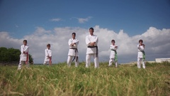 Karate School With Trainers And Young Boys Showing Fighting Techniques Arkistovideo