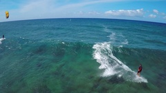 Aerial view of a man kitesurfing in Hawaii. Stock Footage