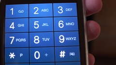 4K smart phone screen dialing number closeup finger typing contact person fast Stock Footage