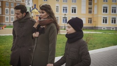 Close up of happy father, mother and son taking a walk together. Family in warm Stock Footage