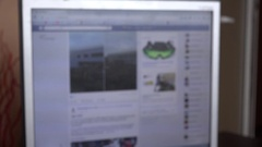 4K blur facebook page on desktop computer people scrolling news feed page slowly Stock Footage