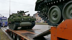 NATO military gear is loaded on platform for transportation Stock Footage