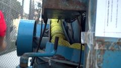 A vintage pitching machine full of yellow baseball balls. Stock Footage