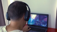 Samui, Thailand - 3 November 2016: Gamer Playing Computer Game Overwatch. Rear Stock Footage