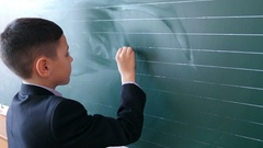 4k, boy solves an example on the board at school 2 Stock Footage