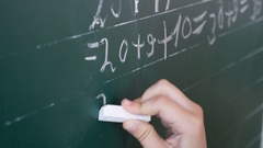 4k, boy solves an example on the board at school 1 Stock Footage