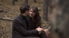 Close up of happy couple is having a date in the forest. Smiling man and woman Stock Footage