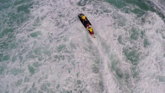 Aerial view of lifeguard surf rescue jet ski personal watercraft in Hawaii, slow Stock Footage