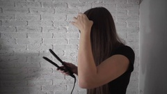 Girl do hair straightening with special equipment Stock Footage