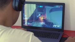 Samui, Thailand - 3 November 2016: Player Winning Computer Game Overwatch Stock Footage
