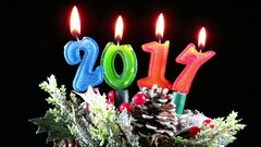 Burning candles for the new year , 2017, on winter  decoration Stock Footage