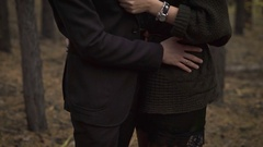 Happy couple in the woods. The man embraces his lover She smiles. A couple in a Stock Footage