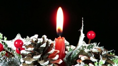 Red candle burning on winter decoration Stock Footage