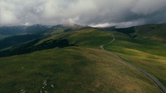 Aerial shot of a highland serpentine mountain road Stock Footage