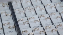 Showcase jewelry store: Engagement gold rings, diamond ring, jewelry Stock Footage