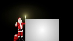 Santa Claus shaking bell presenting a white sheet, fireworks display Stock Footage