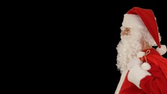 Santa Claus carrying his bag, looks at the camera and winks, fireworks display Stock Footage