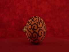 Orange ball on red background Stock Footage
