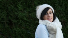 Young brunette woman with a winter cap outside Stock Footage