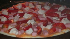 Putting pizza in oven at restaurant kitchen Stock Footage