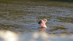Dad and daughter swimming in river, sea, ocean Stock Footage