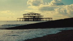Slow motion shot of the derelict West Pier in Brighton, England, UK Stock Footage