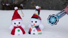 Two snowmen and winter loading symbol Stock Footage