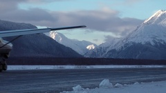 Winter Mountain Small Passenger Plane runway landing taxi Stock Footage