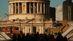 Anonymous crowds walking past the famous St Pauls Cathedral in London Stock Footage