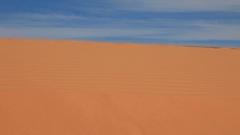 Women's feet walking on a sandy dunes Stock Footage