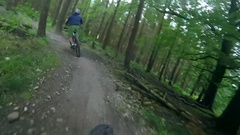 POV view of a mountain biker riding on a singletrack trail, slow motion. Stock Footage