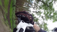 POV view of a mountain biker hand and brake lever. Stock Footage