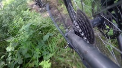 POV view of a mountain biker gears riding on a singletrack trail, slow motion. Stock Footage