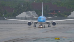 Airplane Boeing 767 towing before departure Stock Footage